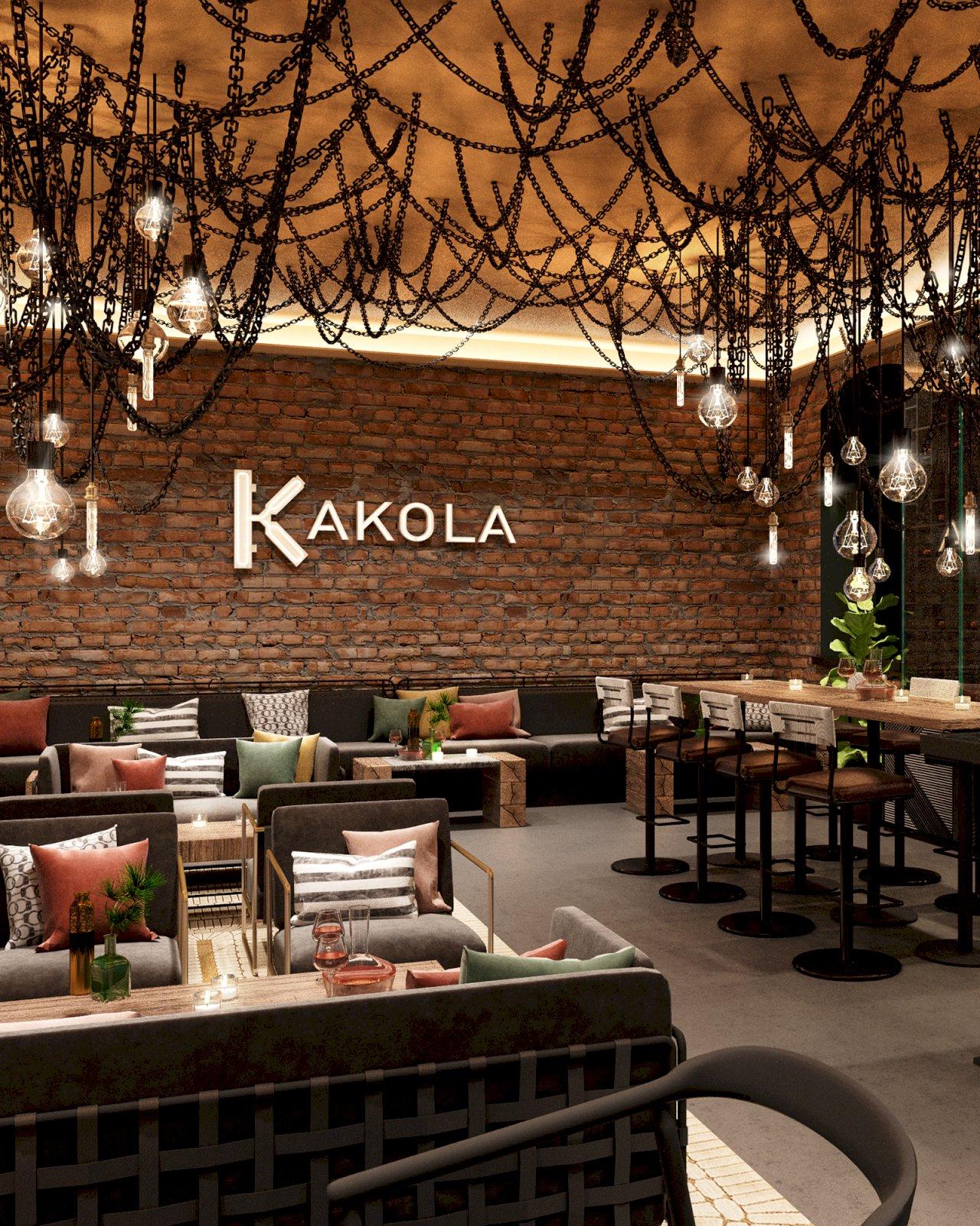 Hotel Kakolan aulassa tiiliseinää ja ketjuista roikkuvia valaisimia.